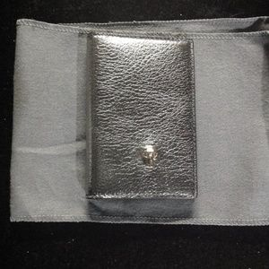 Alexander McQueen Accessories - Alexander McQueen silver leather skull wallet NEW